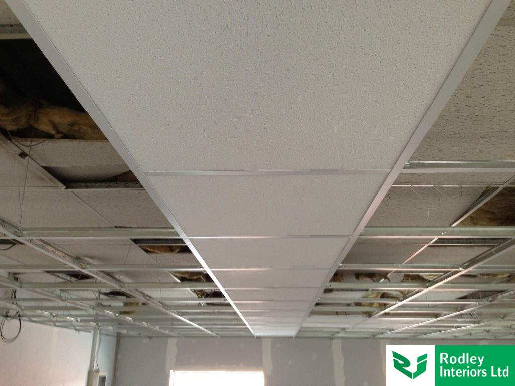 Suspended ceiling with 600mm x 600mm lay-in tiles.