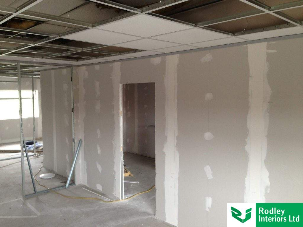 Solid full height partitioning with tape and fill joints.
