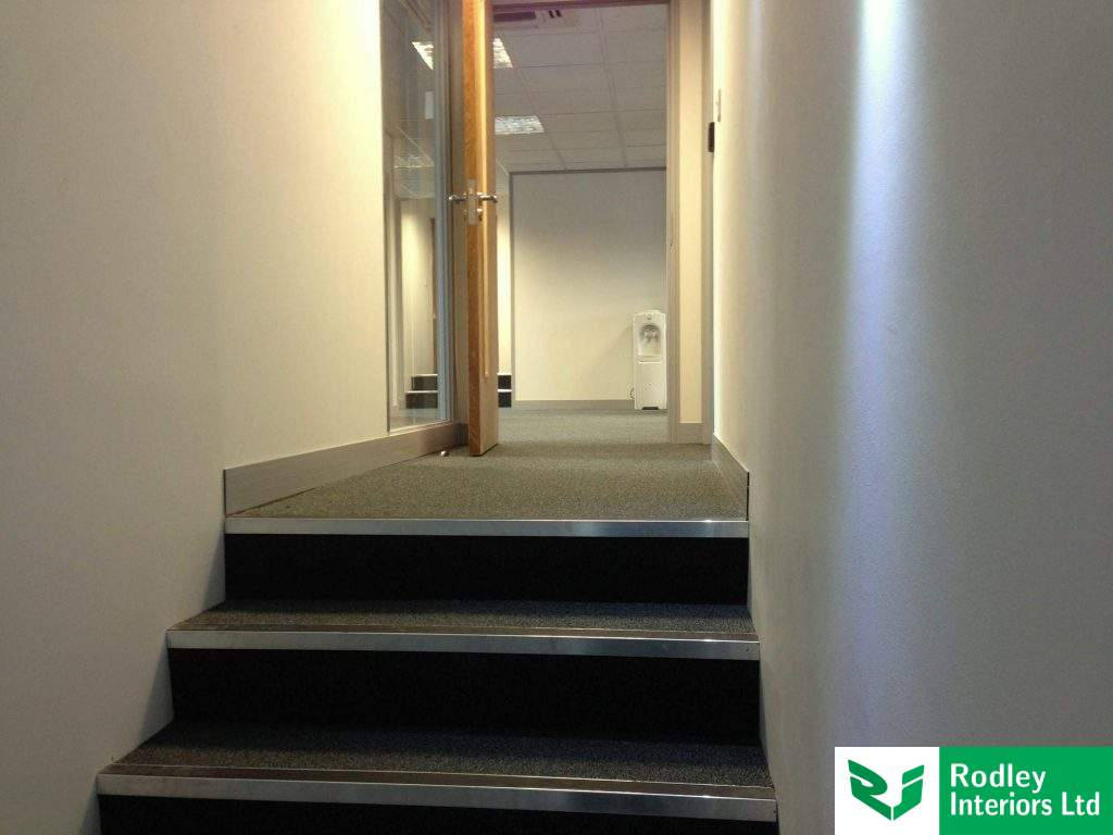 Nosing's to the stair case with Grey office carpet tiles