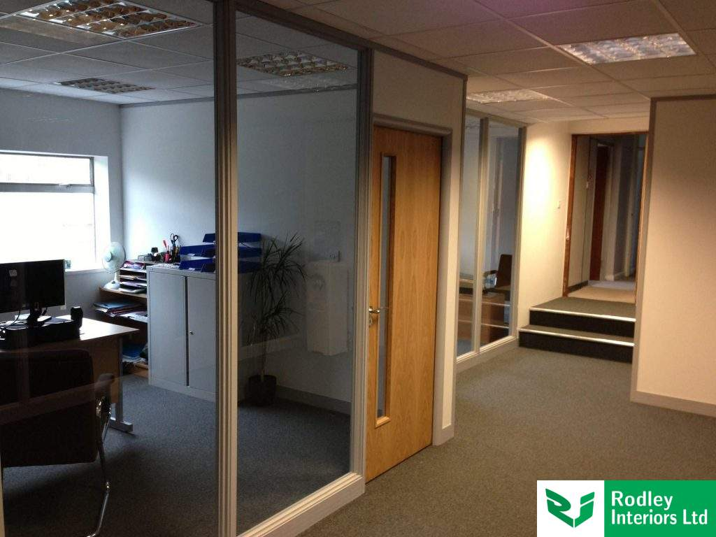 Partitioning system with full height glass and Oak door set