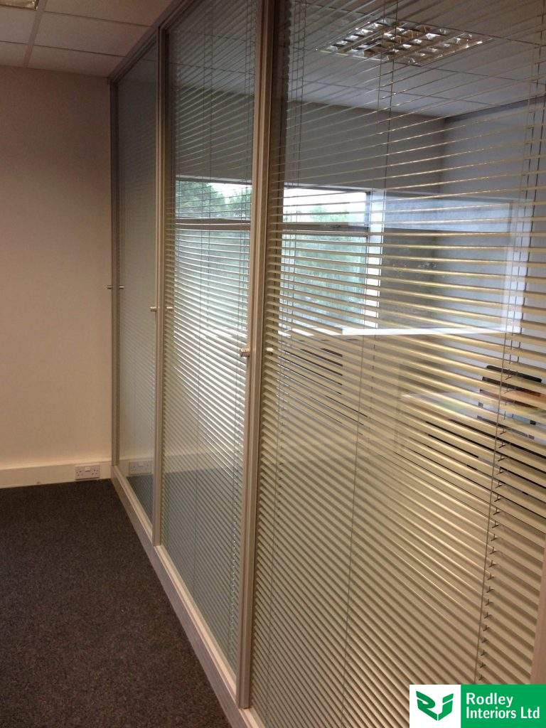 Full height double glazed partitions with Grey blinds