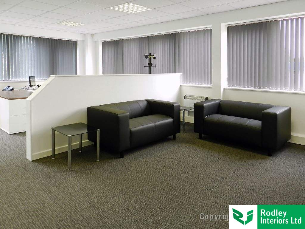 Black leather sofas to the reception area.