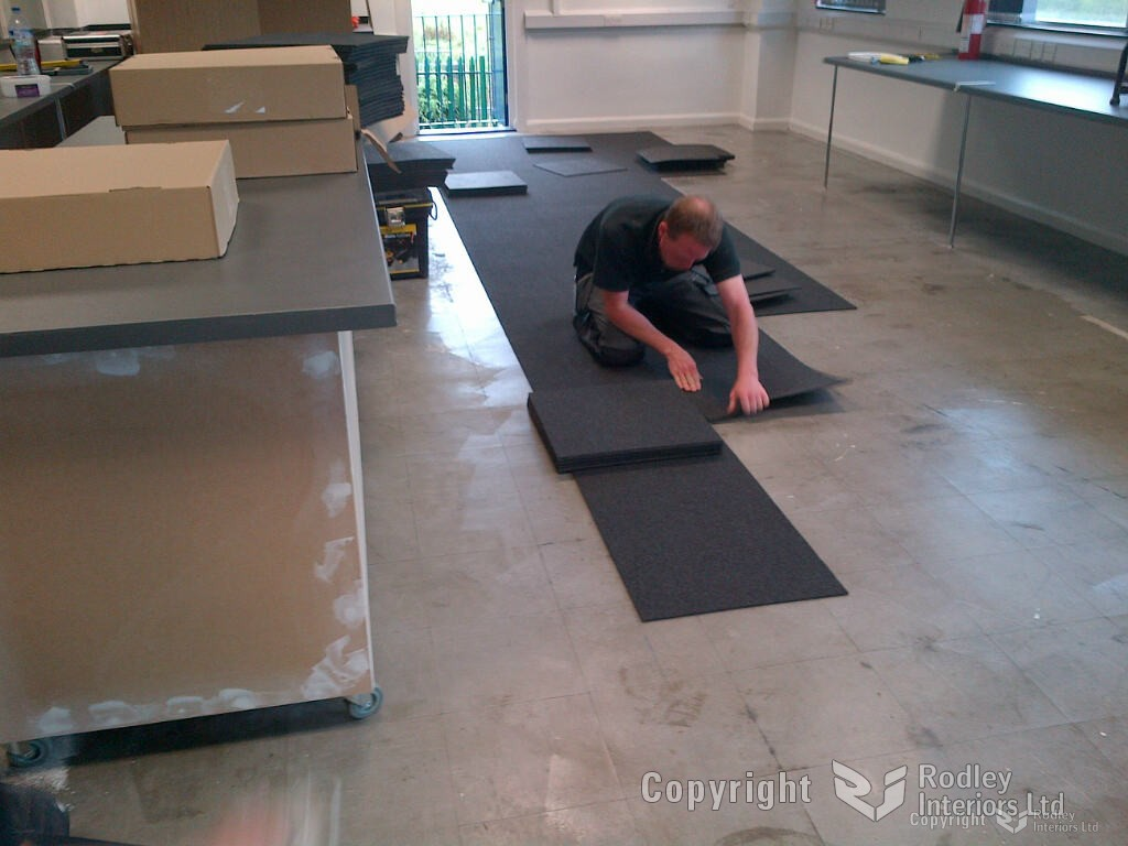 Carpet tiles being laid in office area