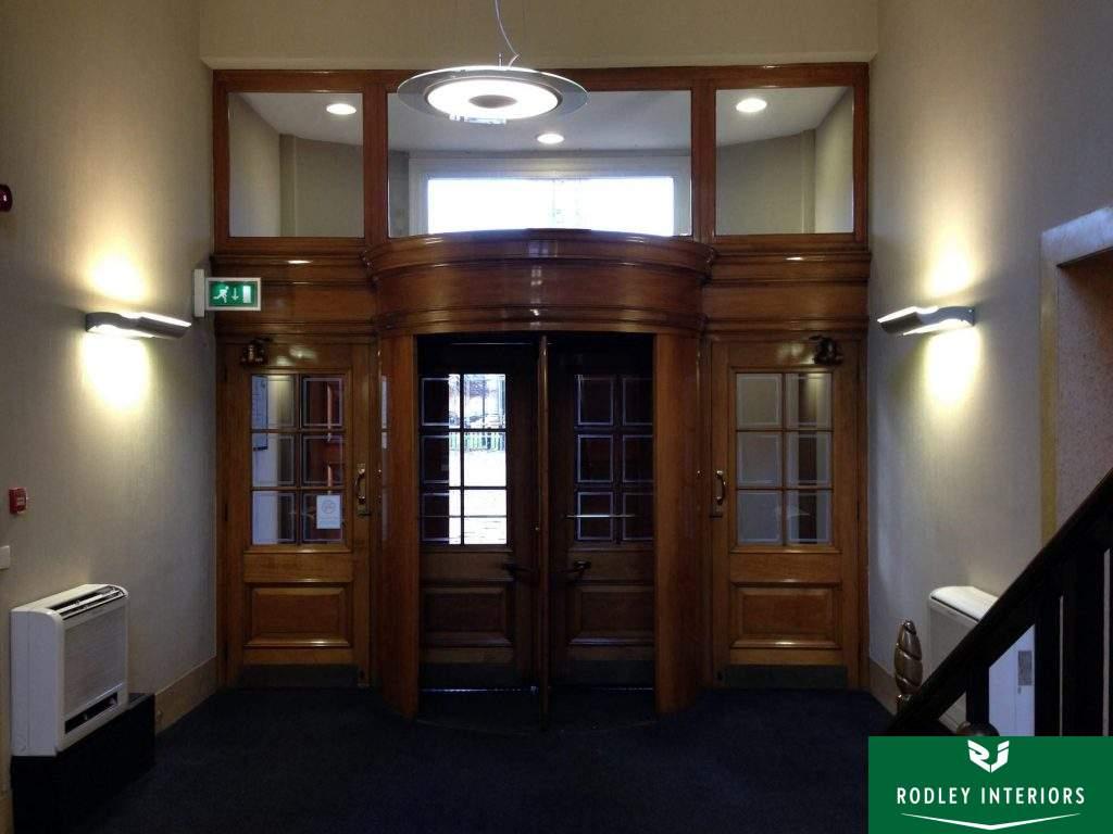 Revolving main entrance door with side doors.