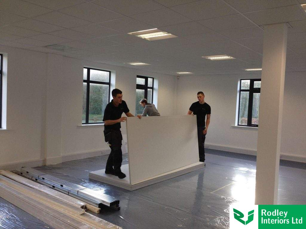 Lifting partitioning materials onto ground floor area