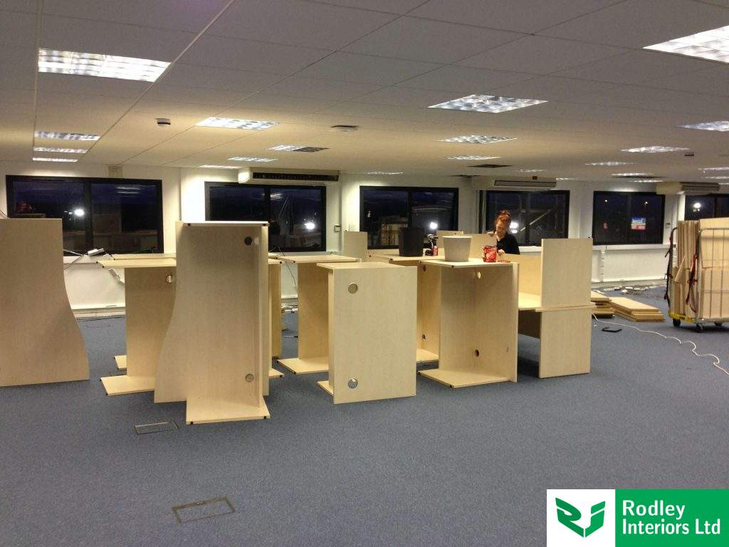 Office furniture being assembled