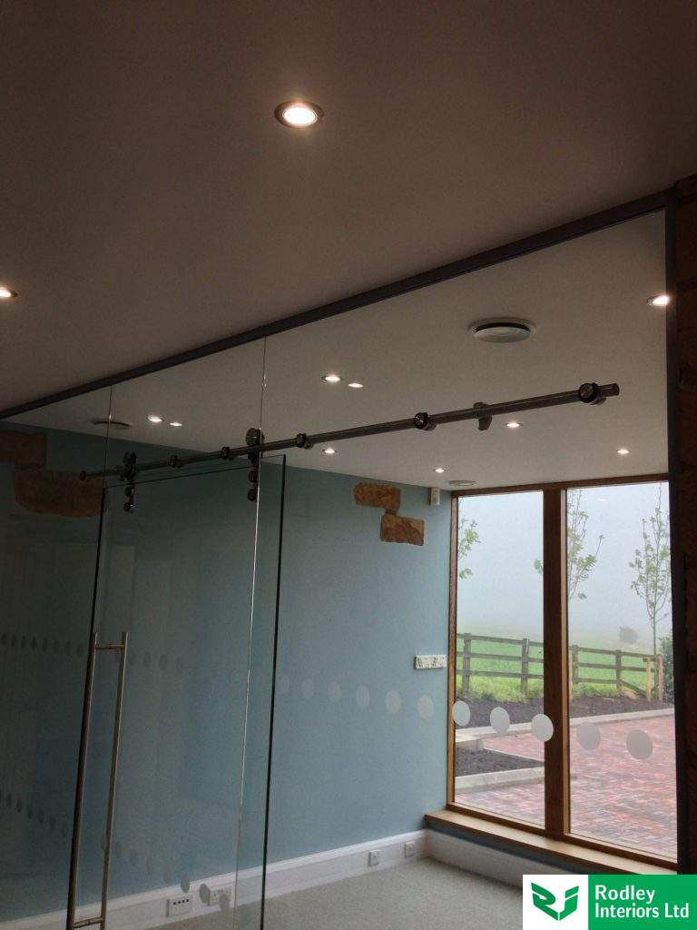 Sliding door for glass partitioning.
