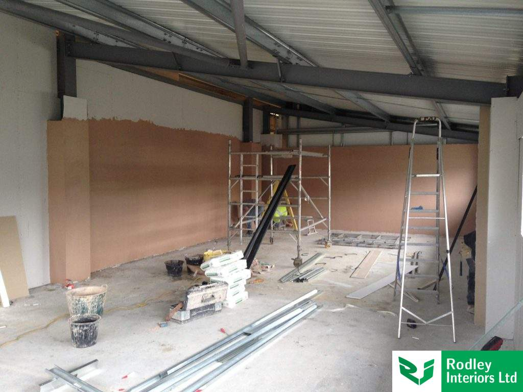Skim finish to office partitioning walls.