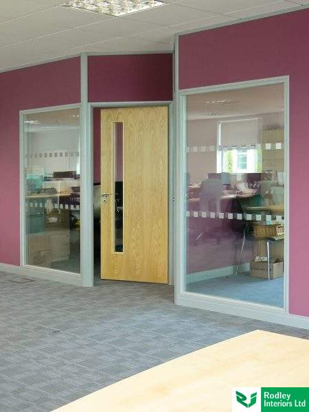 steel stud & plasterboard partitioning with double glazing