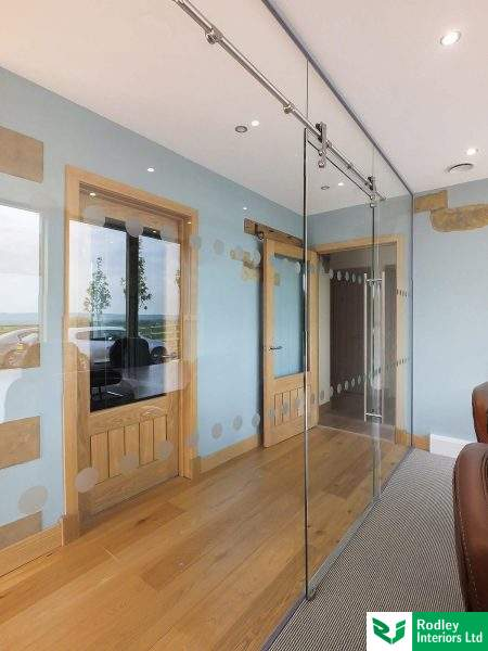 full height glazed partition with full height glass door