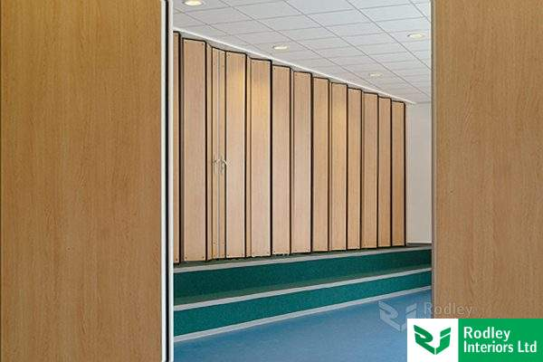 Folding hinged panel wall