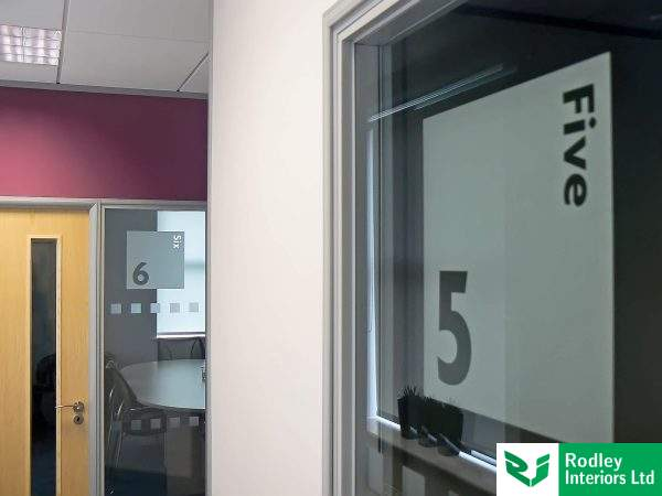 Window film inset into glazed partitioning