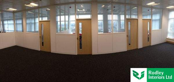 Half height glass partitioning modules fully installed.