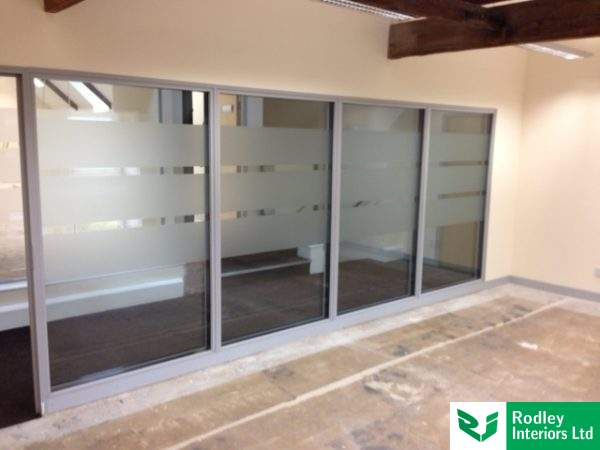 Double glazed partitions with grey framework.