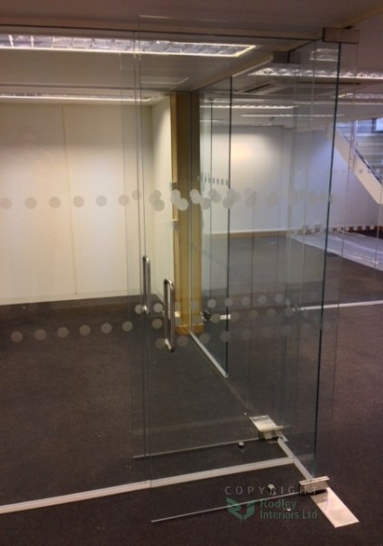 Full height frameless glass doors with back to back D handles.
