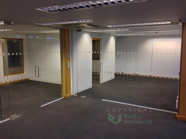 Full height glazed office fronts with 2 rows of manifestation dots.