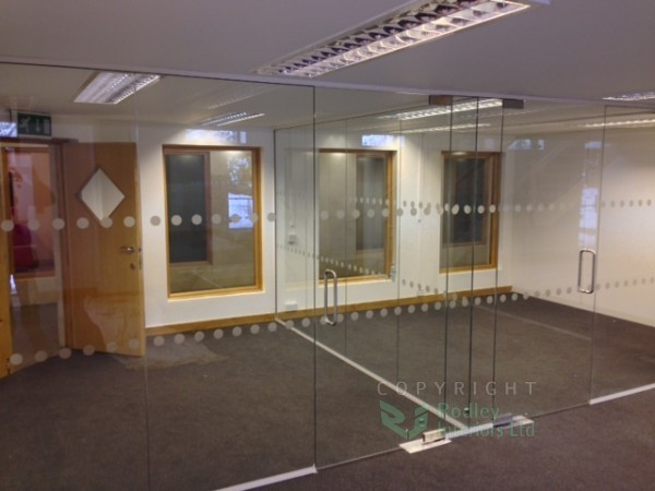 Glazed office screens with white framework.