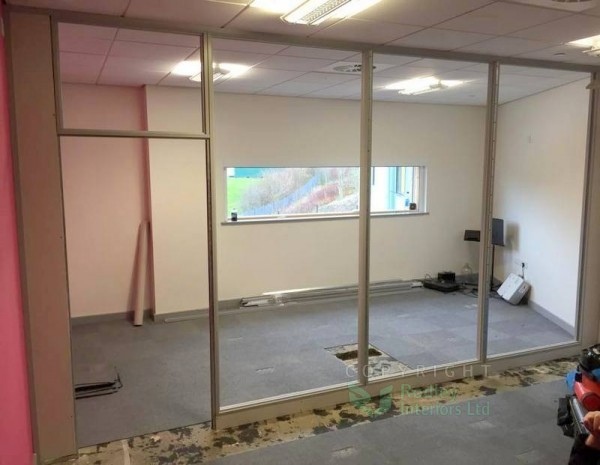 Full height Grey partitioning install underway.