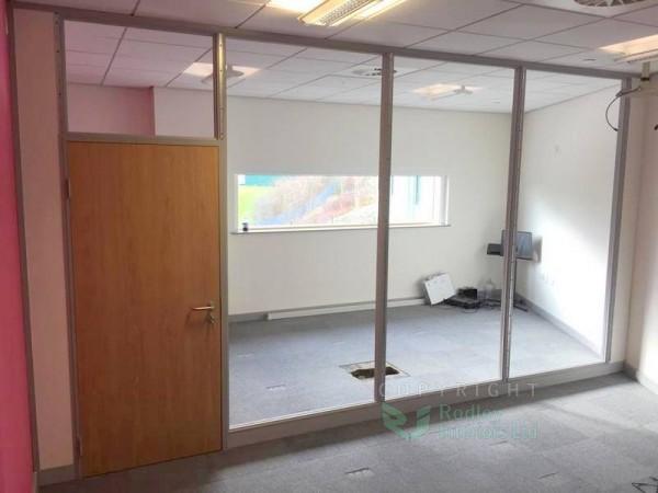 Glazing bead in Grey installed and the single Oak door set.