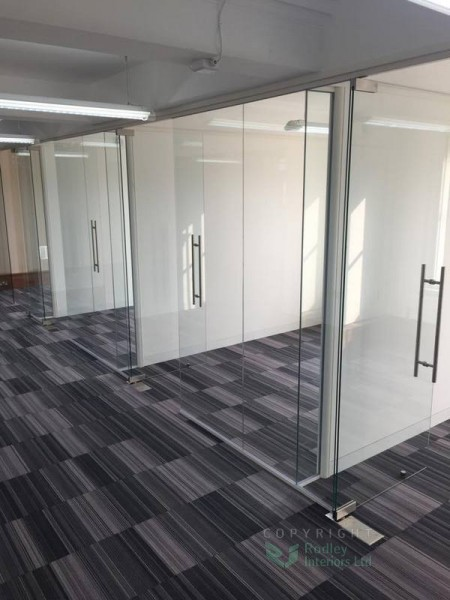 Forming offices with frameless glass.
