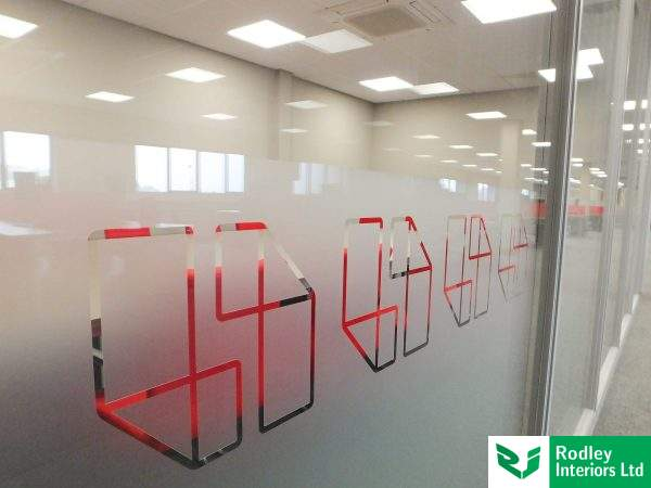 Manifestation film applied to the glass in Opal frost with company logo detail.