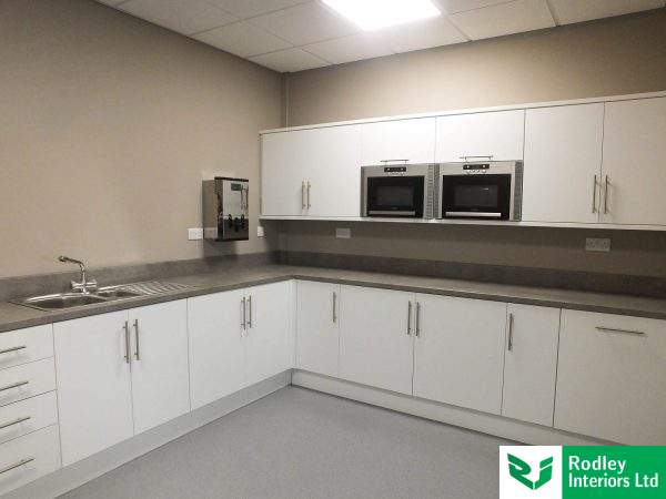 Office kitchen install with White units and White goods installed.