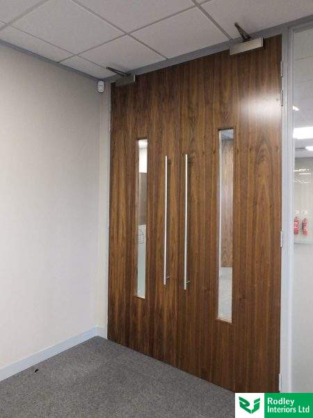 Full height Walnut double door set with back to back T handles and long central vision panel.
