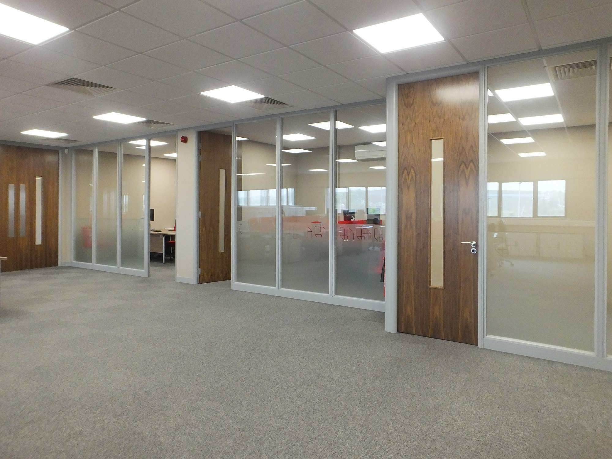 Frameless glass partitioning for Leeds courier office