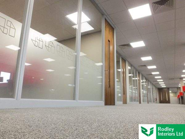 Highly visual run of offices with full height glazed modules.