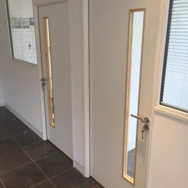 Long vision panels in white office door sets.