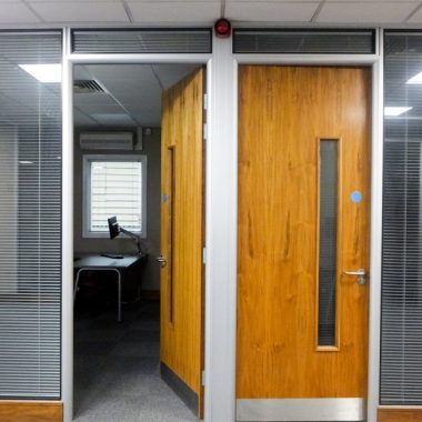 Solid office doors with vision panels.