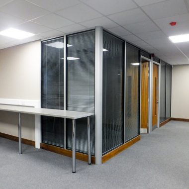 Solid and glass office partitioning.