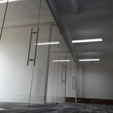 Frameless glass office with handle detail
