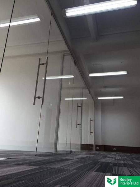 Framless glass doors with back to T handles.