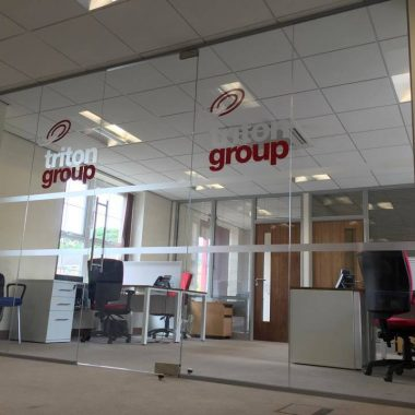 Frameless glass partition aloowing light to flood through