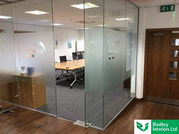 Frameless glass offices matched to the existing