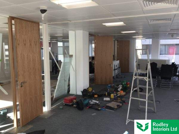 Frameless glass partitions with solid Oak doors