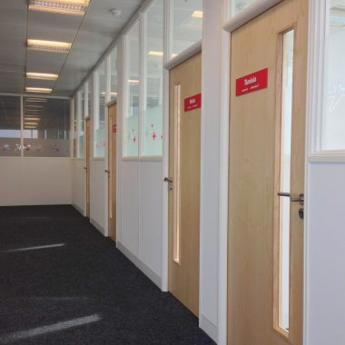 Half height glazed office run in white framewrok