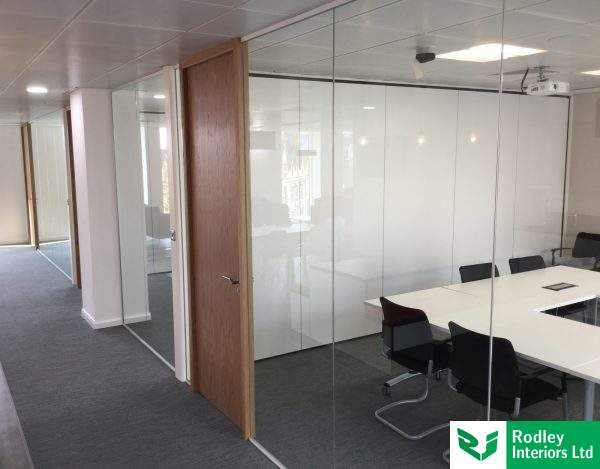 Frameless glass meeting room