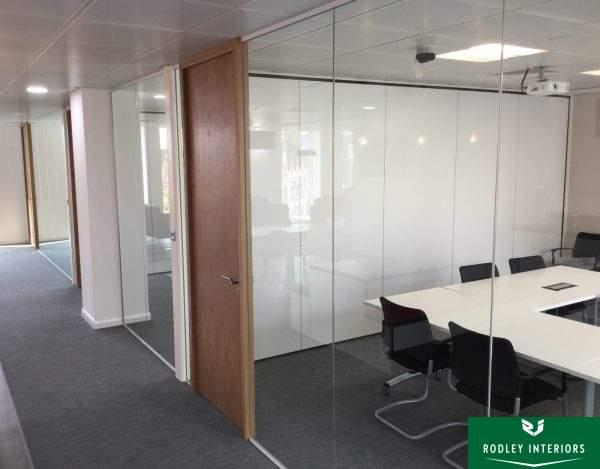 Frameless glass meeting room