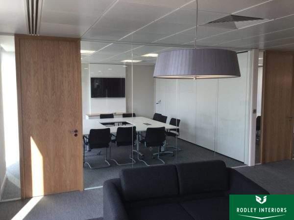 Full height frameless glass meeting room