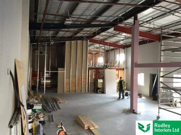 Warehouse office walls being formed.