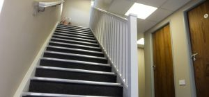 Practical barrier carpet covering the staircase area.