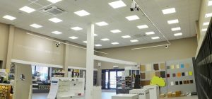 Speciality light fittings fitted within a warehouse area.