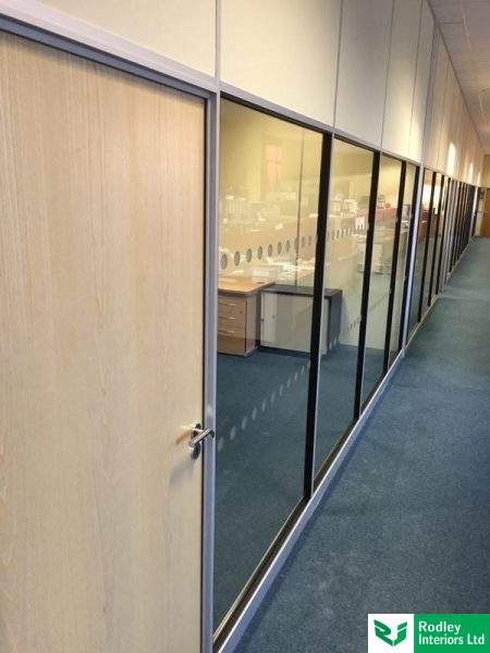 Glazed to door head height partition.