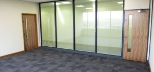 Major benefits of installing glazed office partitions