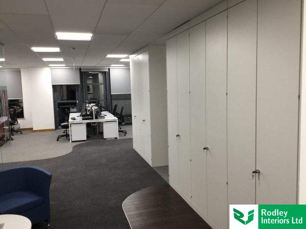 Full height storage walls to end of office