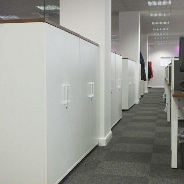 Hinged white door storage cupboards