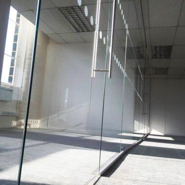 Frameless glass office