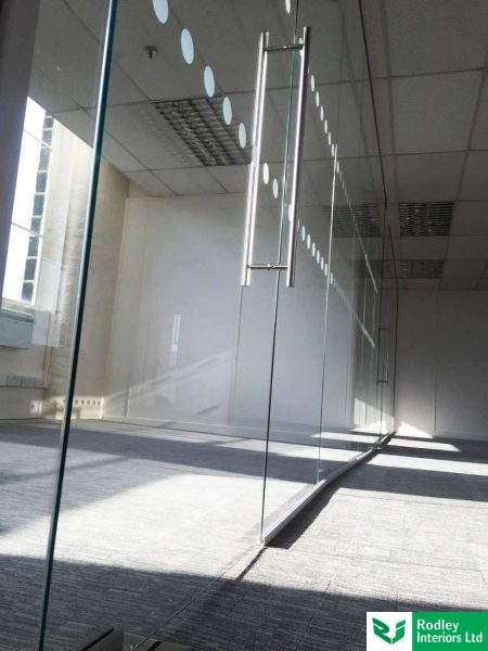 Frameless glass office